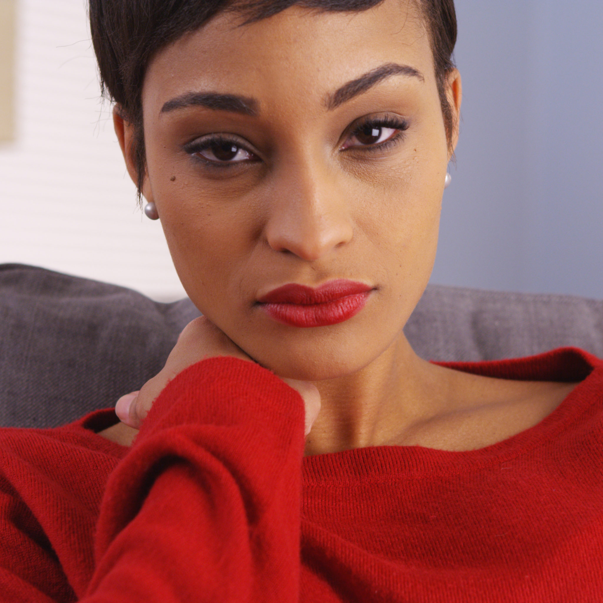 Positive Circles specializes in professional counselling, psychotherapy, mental health and support services for the whole family. Serving the greater Toronto, Canada area. Picture of a sad black woman sitting on couch wearing a red top. www.positivecircles.com