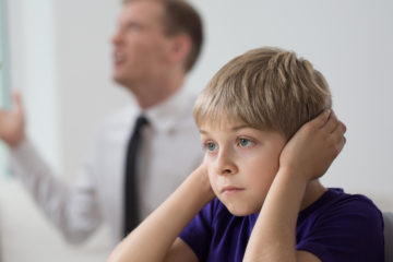 Positive Circles specializes in professional counselling, psychotherapy, mental health and support services for the whole family. Serving the greater Toronto, Canada area. Picture of a white child approximately 6 years old covering his ears while his parents argue in the background. www.positivecircles.com